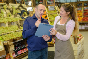 Manager and worker in greengrocers